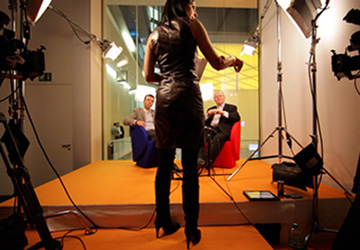 Matthew Bishop, Alejandro Ramirez and Martine getting ready to shoot an episode of Philanthrocapitalism at our DLD2010 studio in Munich, Germany.