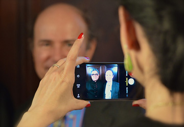 Martine snaps a shot of Deepak & Nobel laureate Dr. Frank Wilczek on the Curious Minds set at Carnegie Science Institute.